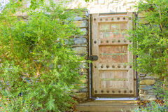 Wooden gate as an entrance to the house Royalty Free Stock Image