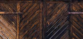 Wooden gate background. A fence made of wood. The texture of the log royalty free stock photos
