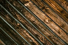 Wooden gate background. A fence made of wood. The texture of the log royalty free stock images