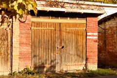 The wooden gate on the barn of red brick Royalty Free Stock Images