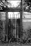 Wooden Gate. Black and white shot of a wooden gate with metal bars Royalty Free Stock Image