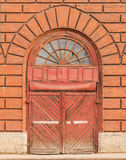 Wooden gate on brick facade Royalty Free Stock Images