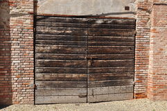 Old wooden gate and brick wall Stock Image