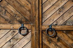 Wooden gate close-up. Antique wooden gate with metal handle. Сlose-up Royalty Free Stock Photography