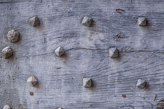 Wooden gate detail. Detail of an old wooden door with a lot of wooden nails royalty free stock photography