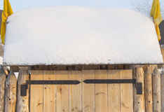 Wooden gate in the fence on a Sunny winter day Royalty Free Stock Images