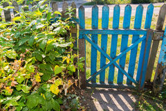 Wooden gate in  garden Royalty Free Stock Image