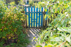 Wooden gate in  garden Stock Images