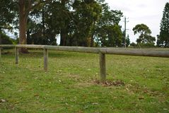 Wooden gate on green grass royalty free stock photos