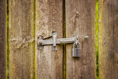 Wooden gate with hinge and padlock Royalty Free Stock Photography