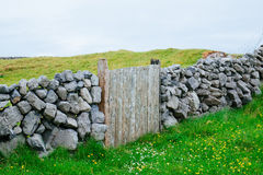 Wooden Gate, Ireland. A stone wall with a wooden gate, shot in Ireland Royalty Free Stock Image