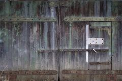 Wooden gate. On iron loops Stock Photos