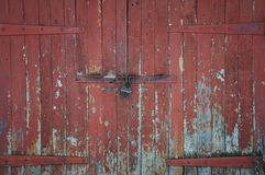 Wooden gate. On iron loops Stock Photo