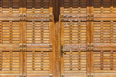 Wooden gate with large rivets Royalty Free Stock Image