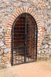 Wooden gate locked steel grate Stock Image
