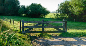 Wooden gate at low sunlight early in the morning Royalty Free Stock Photos