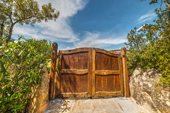 Wooden gate of a luxury house Royalty Free Stock Photos