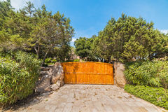 Wooden gate of a luxury house Stock Photo