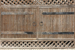 Wooden gate with metal handle Stock Photography