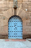Wooden gate, middle ages , Spain. Wooden gate in a stone wall , the middle ages , Spain stock image