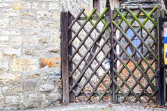 Wooden gate in a narrow street. Stock Photo