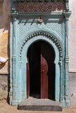 Traditional arabian ornate gate with opened door stock photos