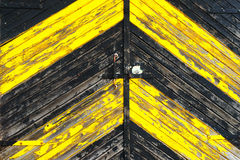 Wooden gate painted yellow and black paint Stock Photo