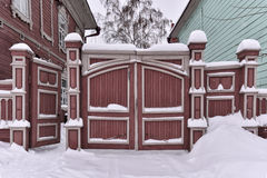 Wooden gate of a residential building of the last century Stock Photo