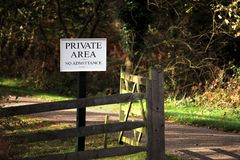 Wooden gate on a road through forest or woodland, with a sign sa. Ying & x22;PRIVATE AREA No Admittance& x22 Stock Image