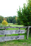 Wooden gate in rurla landscape. Wooden gate in dutch rural landscape with grass and trees stock photos