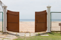 Wooden gate with sea background Royalty Free Stock Photo
