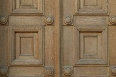 Wooden gate with squares and circles motif stock photos