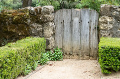 Garden gate and stone fence Royalty Free Stock Photo