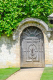 Wooden Gate in Stone Wall Royalty Free Stock Image