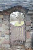 Wooden gate in stone wall Stock Photo