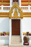 Wooden gate of Thai pagoda. With golden sculptures and stairs stock photos