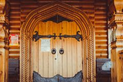 The wooden gate of the church royalty free stock photo