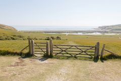 Wooden gate to stop the sheeps i the beautiful green Seven Siste Royalty Free Stock Photos