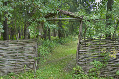 Wooden gate and wicker fence Royalty Free Stock Photo