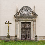 Wooden gates Catholic church. Cross with Jesus and Mary Stock Photography