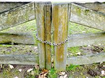 Wooden gates closed by the metal chain royalty free stock photo