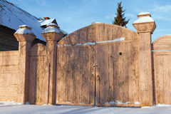 Wooden gates of an old house Stock Photo