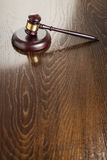 Wooden Gavel Abstract on Reflective Table Royalty Free Stock Photos
