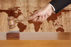 Wooden gavel. On a background map of the world Royalty Free Stock Image