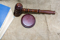 Wooden gavel and book on the old bag Royalty Free Stock Images