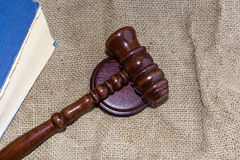 Wooden gavel and book on the old bag Stock Photos