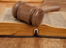 Wooden gavel and books Stock Photos