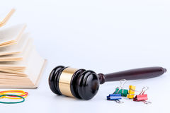 Wooden gavel and books in background. Law and justice concept Royalty Free Stock Image
