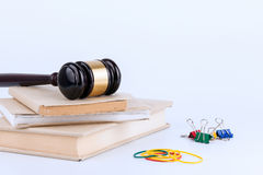 Wooden gavel and books in background. Law and justice concept Stock Image
