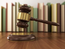 Wooden gavel and books Stock Images